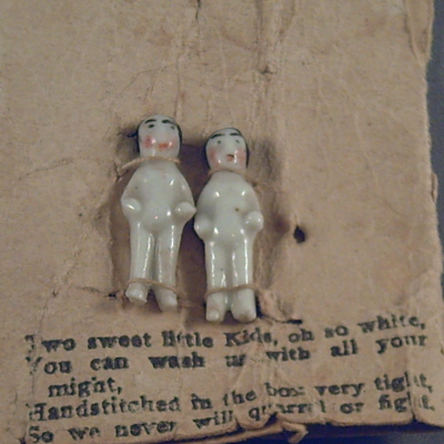 Porcelain pudding dolls on their card